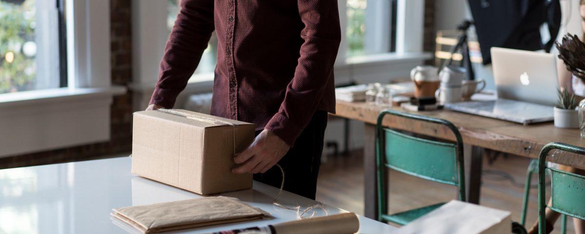 Man inspecting package. Represents packaging testing